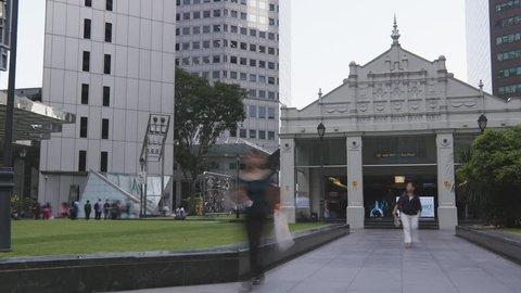 Timelapse of people outside Raffles City MRT Train station in Singapore
