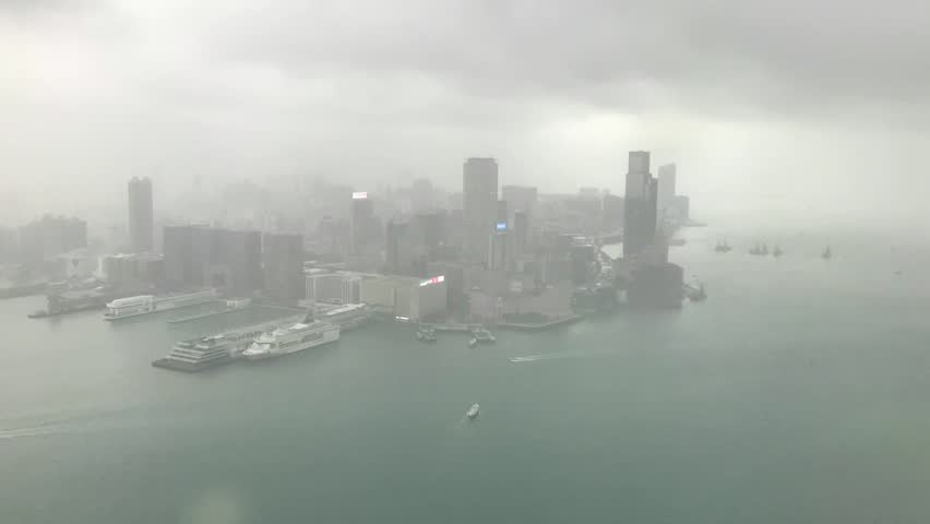 Time-lapse video taken from the highest building in Hong Kong Island. Overseeing the Victoria Harbor and Kowloon Peninsula. Video taken during the storm and cloudy days in summer time. | Shutterstock HD Video #1011291437