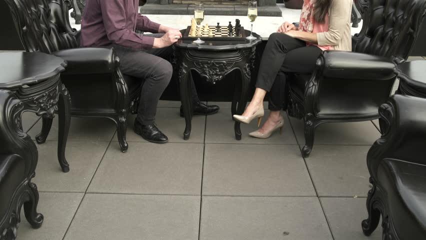 Mature man and a mature woman playing chess   Shutterstock HD Video #1011294317