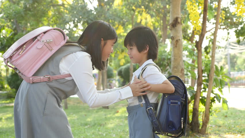 Cute Asian children going to the school outdoors slow motion   Shutterstock HD Video #1011314867