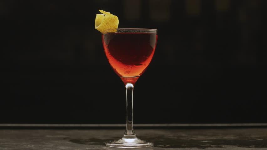 Close up shot of cocktail drink. Food cinematic scene.