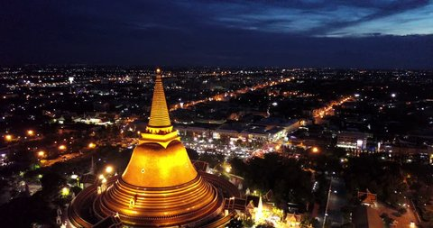 4K. Aerial drone view of Phra Pathom Chedi at dusk, the great golden pagoda and world's tallest stupa in Nakhon Pathom, Southeast Asia, Thailand