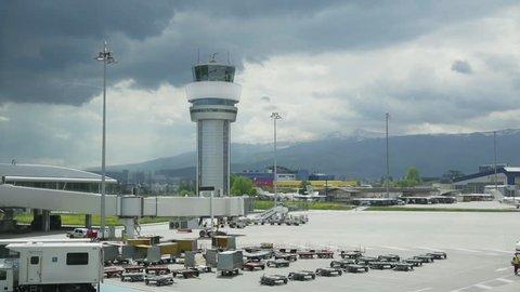 Airport Control Tower. Airport control tower at full capacity. Radar control tower with an airplane across the sky.