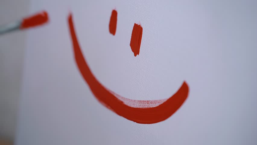 A happy smiley in a childlike style, a girl artist painted a smile on a white canvas