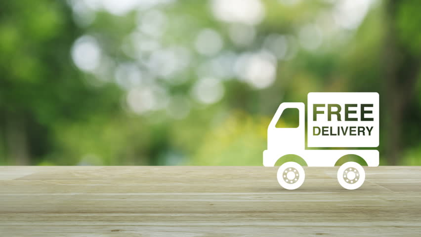 Free delivery truck icon on wooden table over blur green tree background, Transportation business concept | Shutterstock HD Video #1011401837