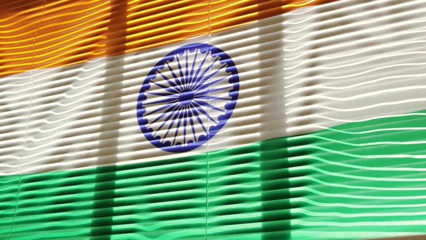 Indian flag is moving from the blowing draft at jalousie window in sunny day. | Shutterstock HD Video #1011412247