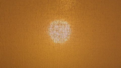 Closeup view of texture of lampshade on table in interior. Turning light on and off using dimmer control.