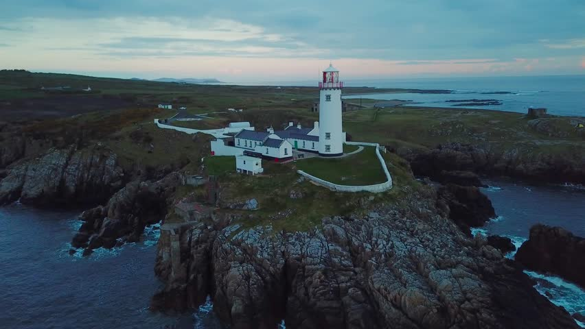 Aerial footage of beautiful lighthouse on a cliff in Fanad, Ireland | Shutterstock HD Video #1011419837