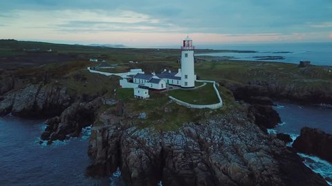 aerial footage of beautiful lighthouse on a cliff in Fanad, Ireland