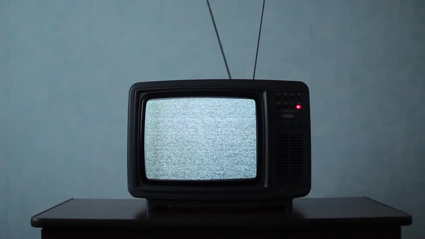Retro TV with white noise in a dark room | Shutterstock HD Video #1011465317