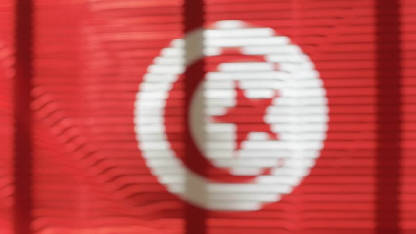 Tunisian flag hanging at wide jalousie window. Closeup  | Shutterstock HD Video #1011468857