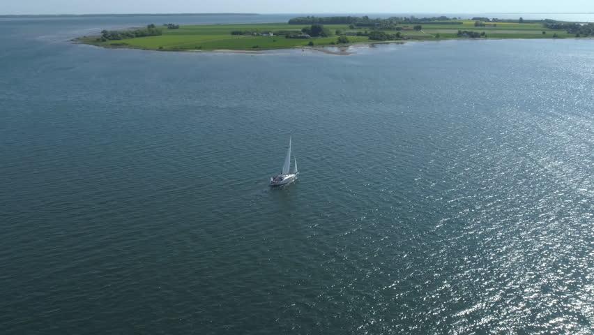 Drone view over sailboat in Jutland, Denmark | Shutterstock HD Video #1011502367