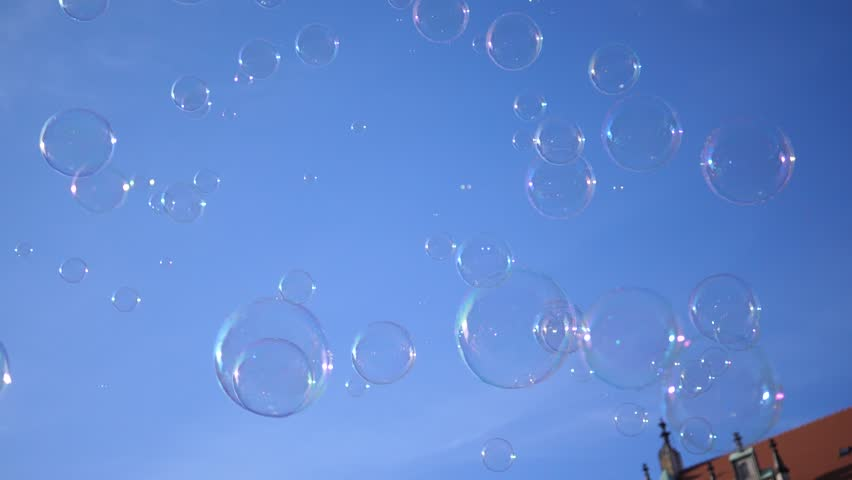 Huge amount of soap bubbles fly on a blue sky background in slow motion   Shutterstock HD Video #1011507947