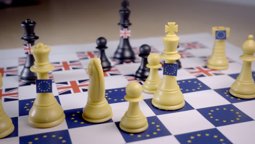 Chess board with European Union and Great Britain pieces, checkmate with the black UK queen. Brexit negociations and strategy concept.