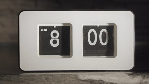 Flip clock mechanism. 8-00 AM. Super slow motion 240 fps.