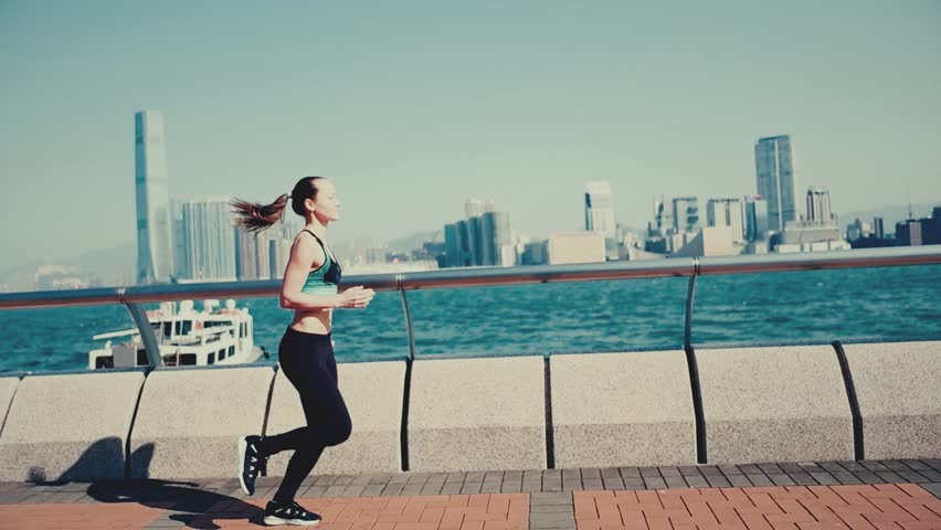 Slow motion. Urban woman running at hight speed in Hong Kong city. Cinematic style. | Shutterstock HD Video #1011585947