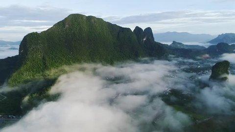 Sea of mist mountain blue sky bird eye view drone