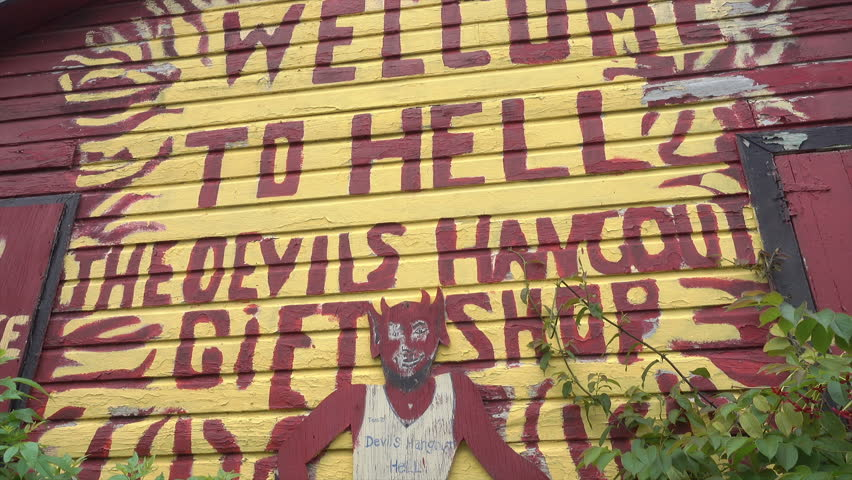 HELL, GRAND CAYMAN/CAYMAN ISLANDS - JANUARY 20, 2018: Welcome to Hell sign on gift shop, Grand Cayman Islands, Caribbean. Hell refers to an open space filled with clusters of short black limestone. | Shutterstock HD Video #1011610427