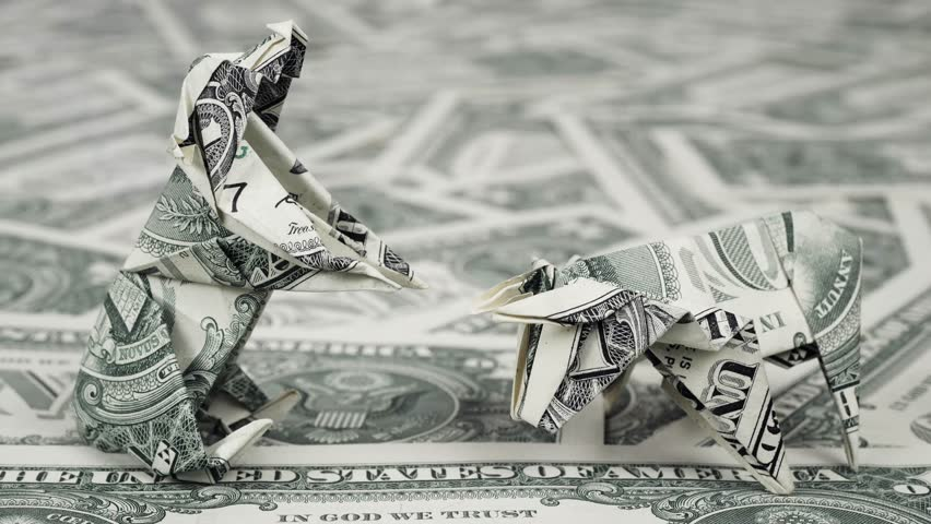 Bear and bull market concept Dollar origami close up | Shutterstock HD Video #1011643997
