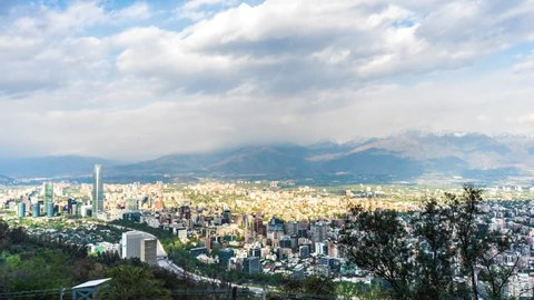 SANTIAGO DE CHILE - NOVEMBER 22: Panoramic time-lapse view over the city and the surrounding nature on November 22, 2015 in Santiago de Chile.