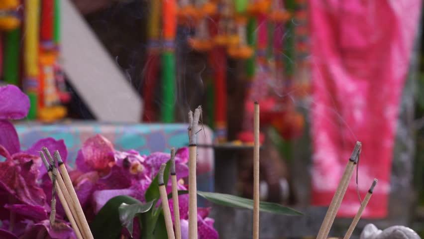 Burning Incense Joss Sticks for Blessings in Temple