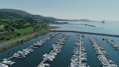 Aerial footage of Largs Yacht Haven, a large marina on the Firth of Clyde.