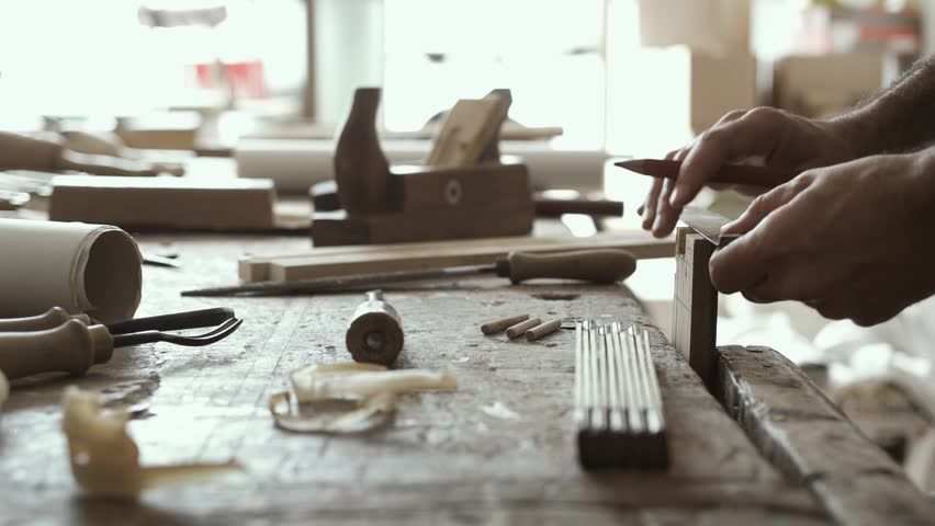 Professional skilled carpenter working on a woodworking joint, crafts and carpentry concept | Shutterstock HD Video #1011737597