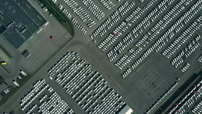 Aerial top down view of a new cars warehouse
