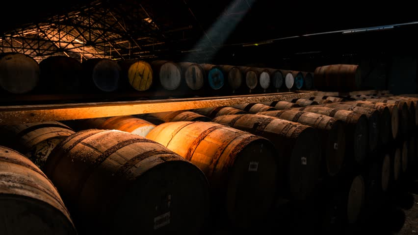 Timelapse of a shaft of light moving across barrels of whisky, Scotland | Shutterstock HD Video #1011795197