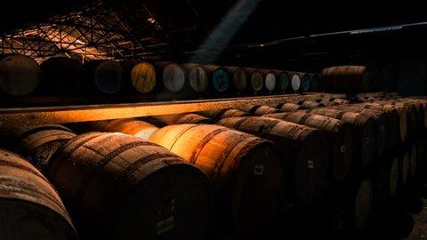 Timelapse of a shaft of light moving across barrels of whisky, Scotland