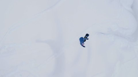 Aerial View of Snowboarder Jumping Gap