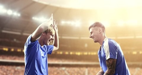 Soccer players celebrate a victory, clap their hands and hug happily on the professional stadium while the sun shines. Stadium and crowd are made in 3D and animated.