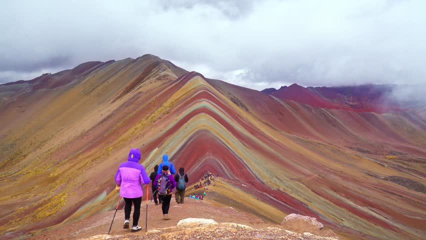 View on one of nature wonders, the Rainbow mountains in Peru with people visitng at 5200 meters