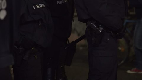 Police officer holster with gun and baton club, German Polizei, Berlin
