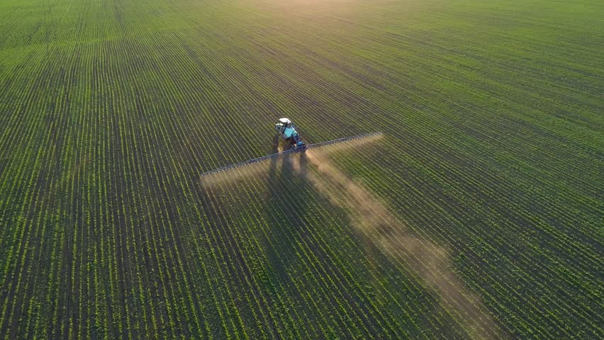 4K aerial drone footage. Following tractor sprayer on soybean fields at sunset | Shutterstock HD Video #1011978197