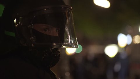 GERMANY - CIRCA MAY 2017 - Anonymous ski mask riot police officer, protective helmet gear, close up, Berlin