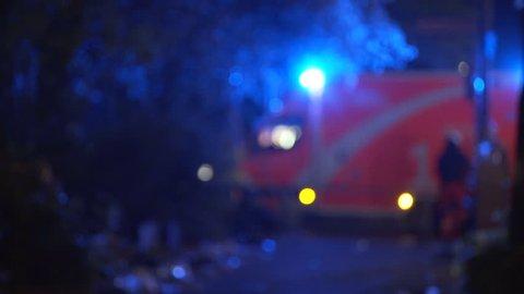 Ambulance emergency health service vehicle, doctor paramedics, nighttime