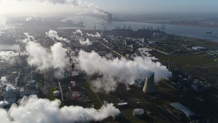 Aerial footage of nuclear power plant or nuclear power station a thermal power station in which the heat source is a nuclear reactor this plant is located in a heavy industrial zone 4k quality