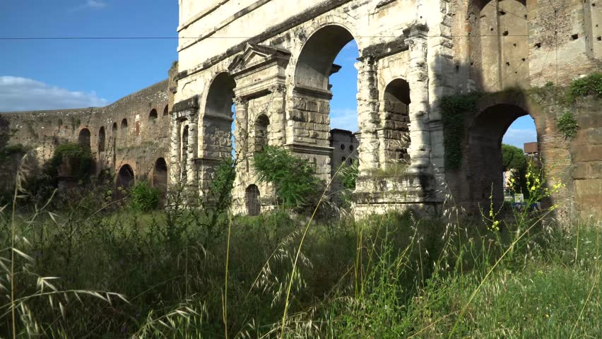 """The Porta Maggiore (""""Larger Gate""""), or Porta Prenestina, is one of the eastern gates in the ancient but well-preserved 3rd-century Aurelian Walls of Rome."""