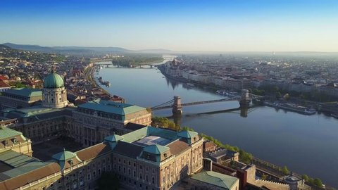 Budapest, Hungary - 4K Aerial skyline view of Budapest with Buda Castle Royal Palace, Szechenyi Chain Bridge and River Danube at sunrise