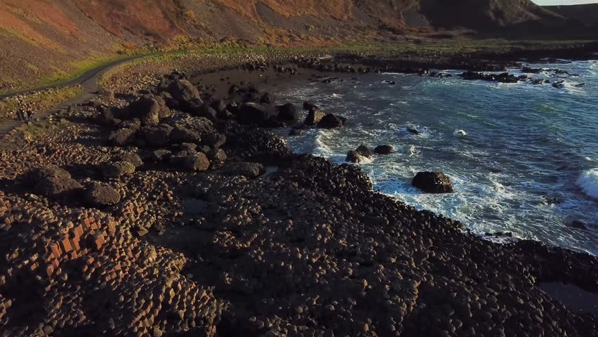 4k Aerial Shot of Giant's Causeway rocks in Northern Ireland | Shutterstock HD Video #1012074527