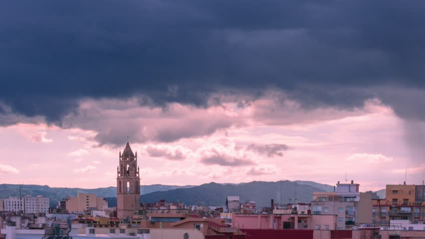 Belfry of St. Peter in Reus, Tarragona. Catalonia (Spain). Timelapse of dark storm clouds and rain | Shutterstock HD Video #1012082897