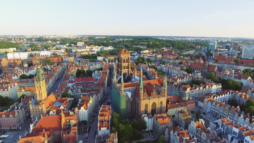 The old town of Gdansk architecture in sunset light. Aerial shot. Channel and buildings - top view | Shutterstock HD Video #1012102307
