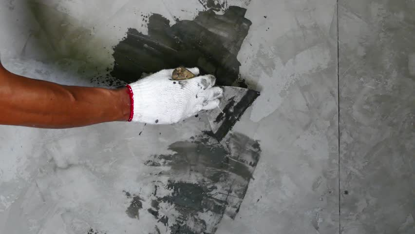 Professionals construction worker painting wall house in loft polished cement style | Shutterstock HD Video #1012120127