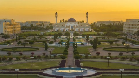 Beautiful high angle time lapse of sunrise view overlooking Sultan Qaboos University Mosque in Muscat, Oman. Full HD 1080p. Pan Up Motion Timelapse