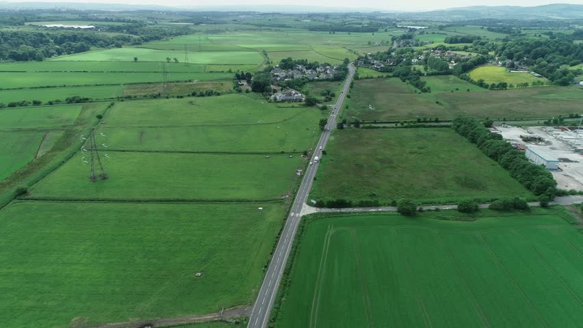 Aerial footage looking towards the small village of Balmore in East Dunbartonshire, Scotland.