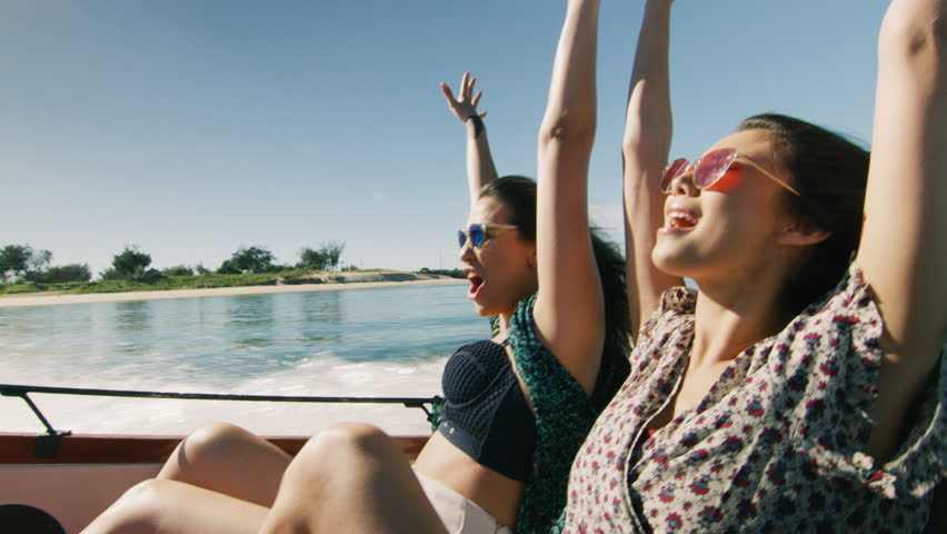 Two beautiful girls having fun on a boat. Shot with a RED camera. 4k footage.