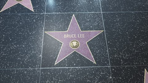 Hollywood, CA, USA - 05/03/18: Hollywood Walk of Fame Star with Bruce Lee's name. Wide and CU Detail. For editorial purposes. Must get approval for 'commercial' use
