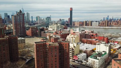 This video shows aerial views of  downtown Brooklyn, Dumbo, Vinegar Hill, New York Housing, and the Manhattan Bridge.  Skyline views of downtown Brooklyn and New York City are in the back drop.