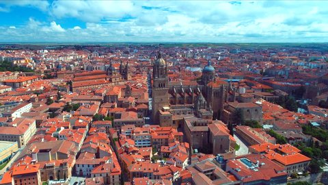 484 Aerial 4k with the  New Cathedral from the Plaza de Anaya in Salamanca. The New Cathedral was constructed between the 16th and 18th centuries in two styles: late Gothic and Baroque.